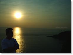 Hosea reflecting life at the Phuket sunset.